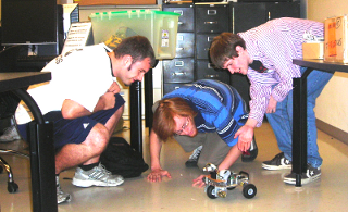 Students and a robot