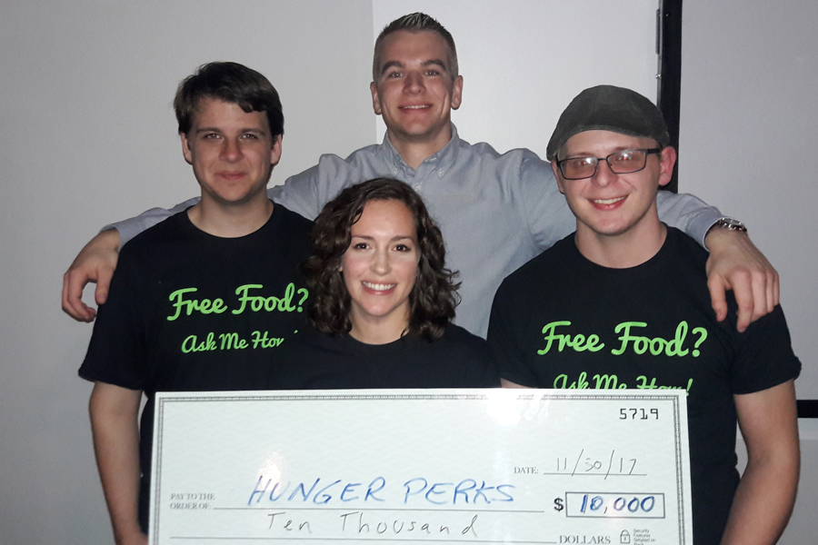 HungerPearks team with big check