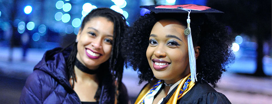 Two University of Akron students at Commencement.