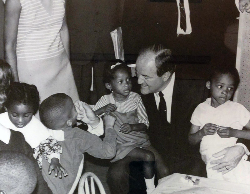 Vice President Hubert H. Humphrey visits with children in Akron's Elizabeth Park during a 1968 visit to Akron.