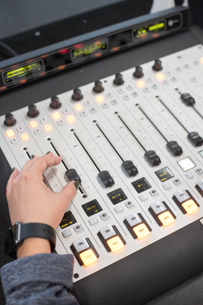 A media studies student learning audio production.
